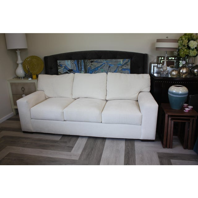 Cream woven three seater Century sofa. Incredibly comfortable and in great condition
