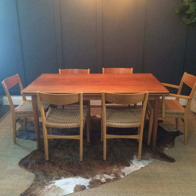 "Beautiful vintage mid-century modern extending dining table and chairs. Table has stamp marked ""Made in Denmark"" and can..."
