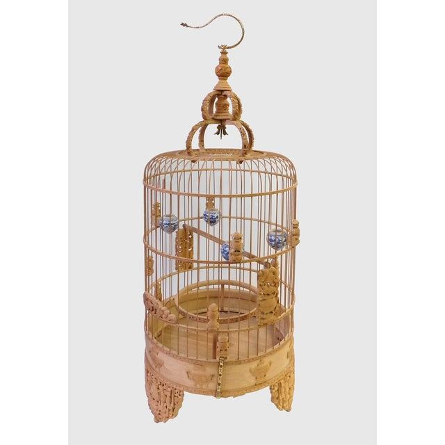 This is a hand-carved art collectible birdcage display. It is made of bamboo and wood. There are precise relief carvings...