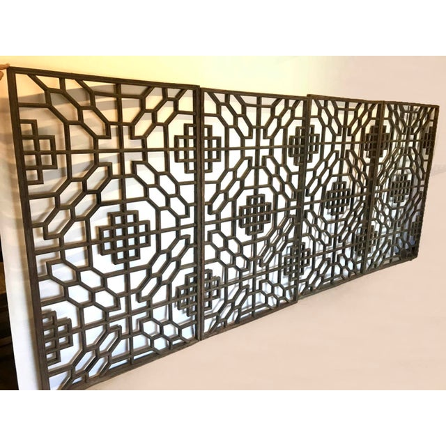 Set of four 19th century stunning, intricate lattice panels from Japan. Wood with naturally worn patina; traces of...
