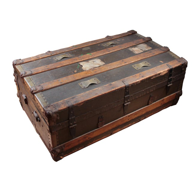 This beautiful antique wooden flat top trunk dates back to the late 1800's- early 1900's. The original wooden slats and...