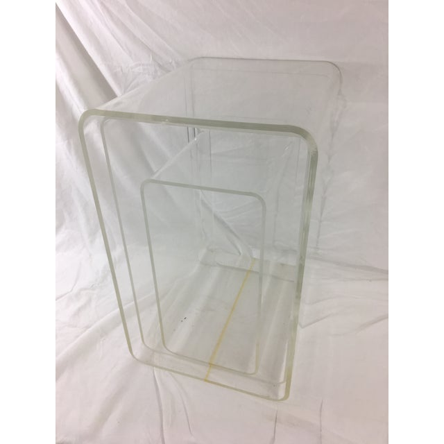 """This awesome set of lucite nesting tables are transparently cool. The tallest measures 12.5"""" wide, 15.75"""" deep and 20.5""""..."""