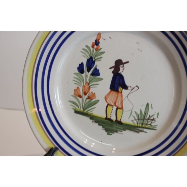 Pair of French hand painted Quimper plates. Both signed.