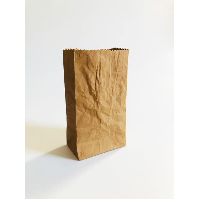 A wonderful vintage pop art pottery vase in the shape of a paper bag. Made by Michael Harvey in the 1980s. Great realistic...
