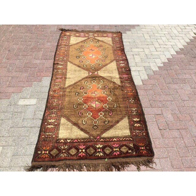 One of a kind hand made vintage Anatolian rug. This gorgeous hand knotted area rug was made in the 1960's by Anatolian...