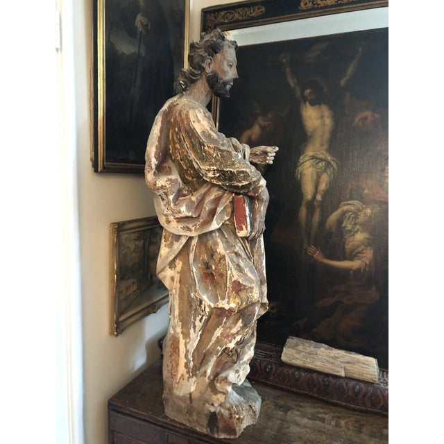Rare Hand Carved Wood & Gesso Polychrome Statue of an Apostle. Holding a Book or Bible. What remains of the original paint...