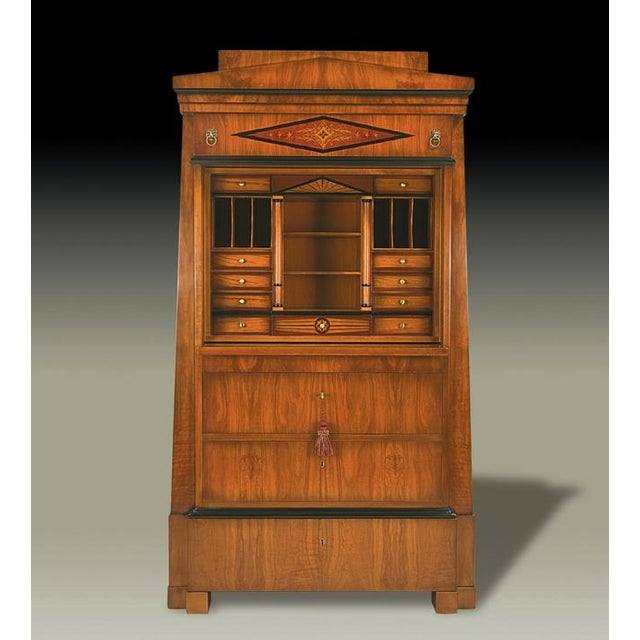 A monumental silhouette drawn from the tapering height of an ancient Egyptian doorway distinguishes this Biedermeier...