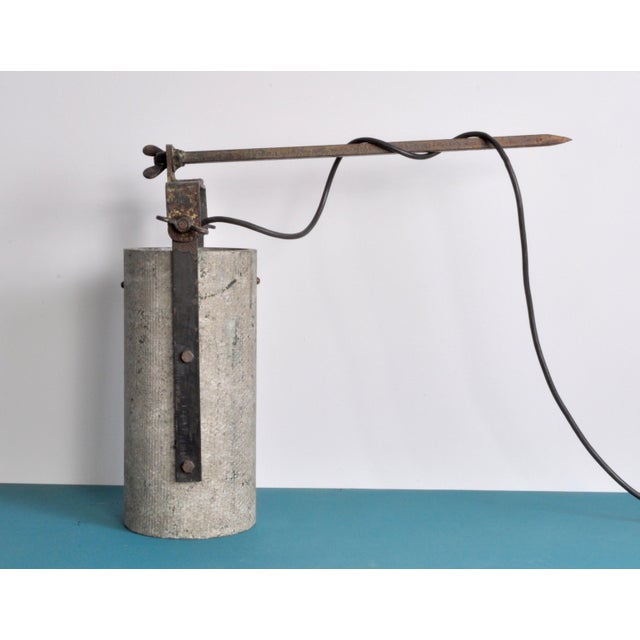 A pair of staggering industrial chic fiber concrete outdoor lanterns with well aged metal hardware. We have replaced three...