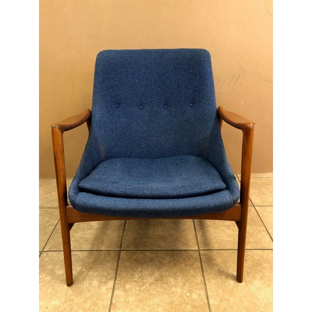Danish modern lounge chair. Has a teak frame with original upholstery. Nice chair for a mid-century modern interior.