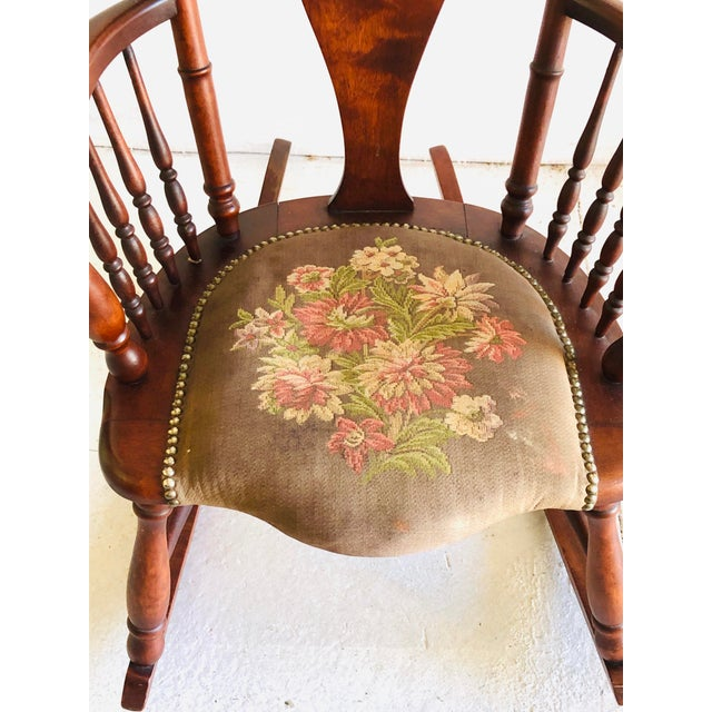 Victorian rosewood and tapestry rocking chair.