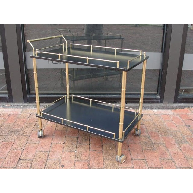 Two-tier and brass faux bamboo bar cart.