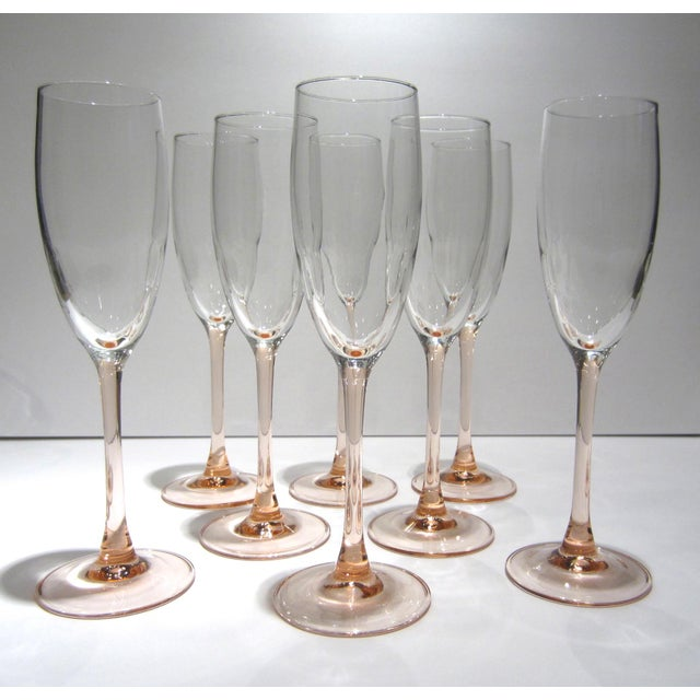 """A beautiful set of eight champagne flutes with crystal bowls and blush pink stems. Marked """"France."""" Excellent condition."""