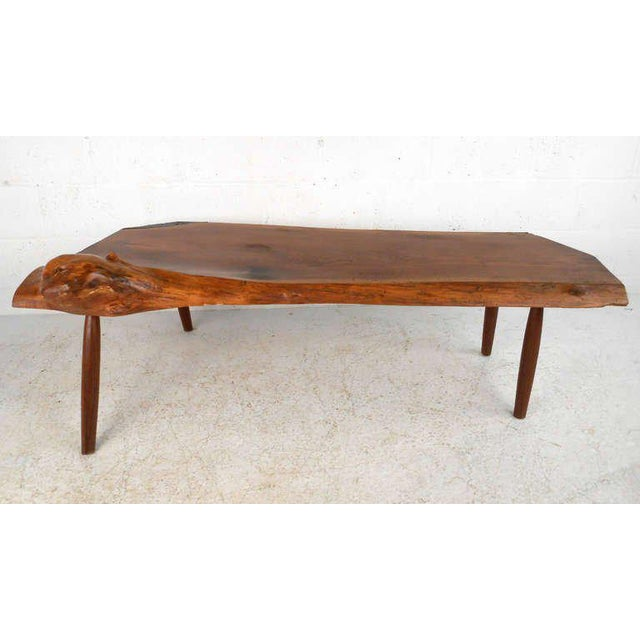 This wonderful natural cut wood slab coffee table top features unique natural details that add to the beauty of the table....