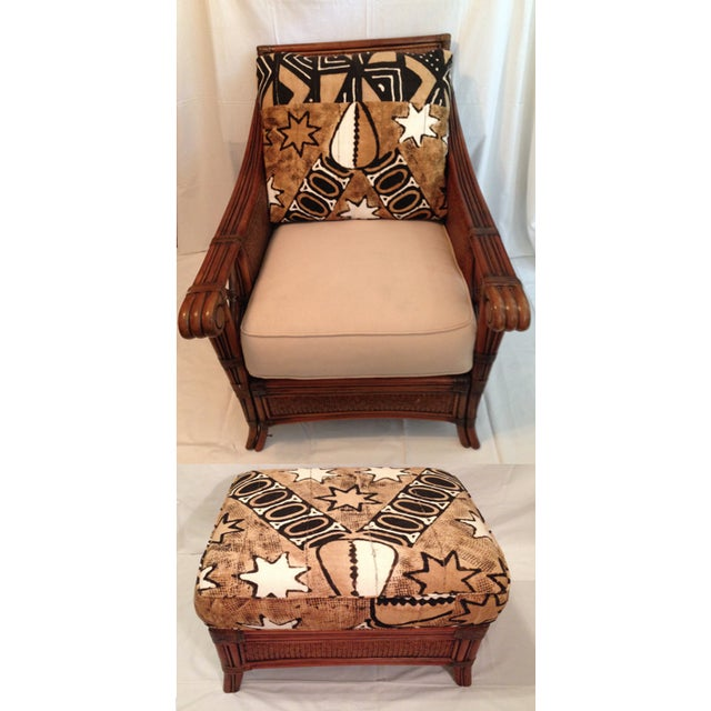 Distinctive oversized Padma Plantation chair and ottoman covered in African batik fabric. Rich rattan texture in British...