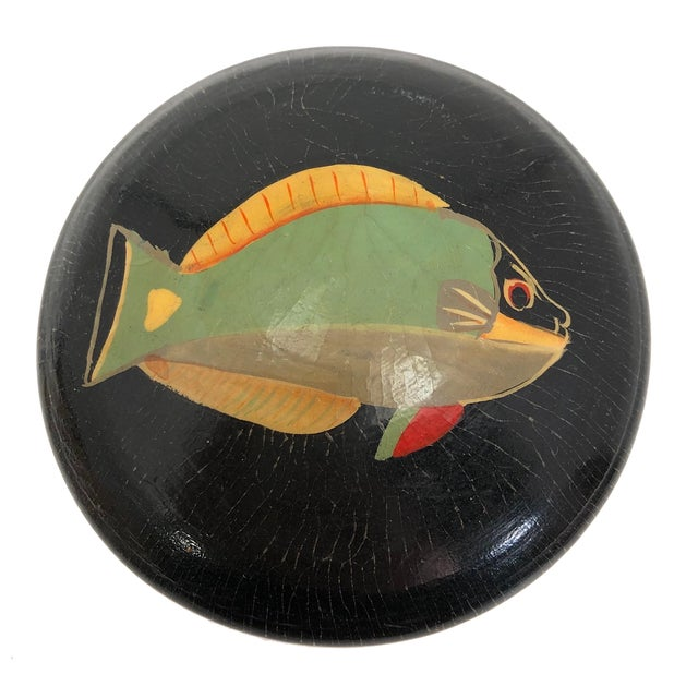 I believe this wonderful vintage turned wood trinket box with hand-painted fish on top is likely one of a kind; I have...