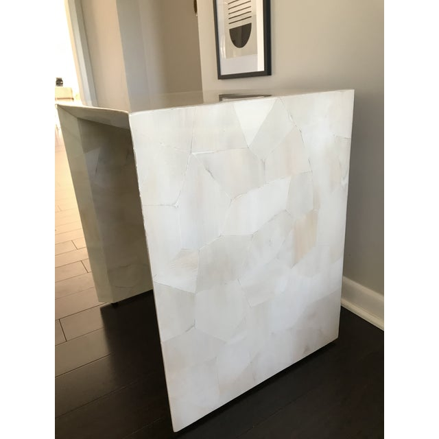 Truly beautiful hand-laid faux horn mosaic pattern finish on a sleek waterfall-style side table. Jozlyn Side Table by...