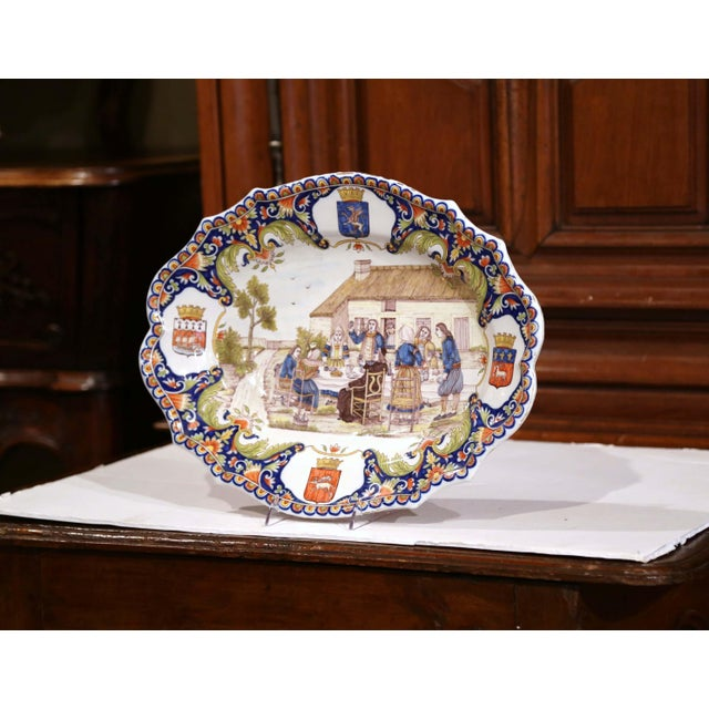 This large ceramic platter was sculpted in Brittany, France, circa 1880. The colorful, antique plate features a hand...