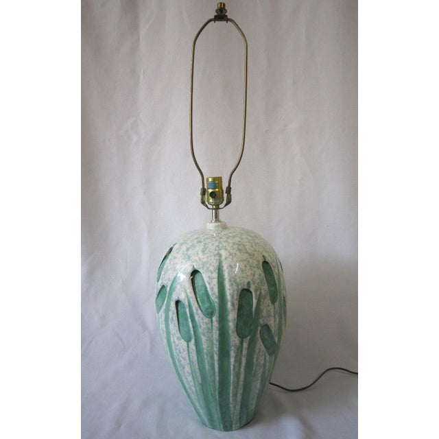 Charming Art Pottery lamp with sheathes of wheat on all sides. A pale green and white combination. The wiring is in good...