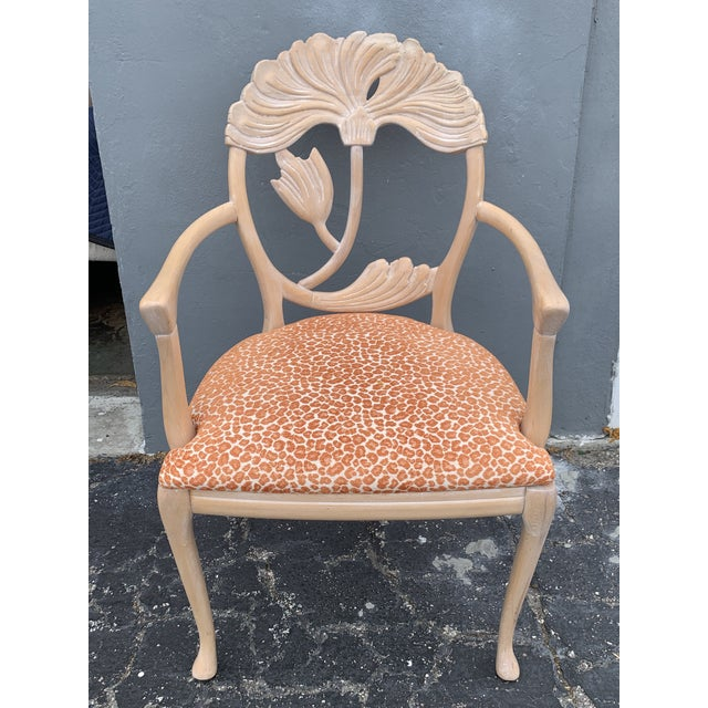 An inspired rendition of a traditional form, these Italian made dining chairs have a large floral carving within an oval...