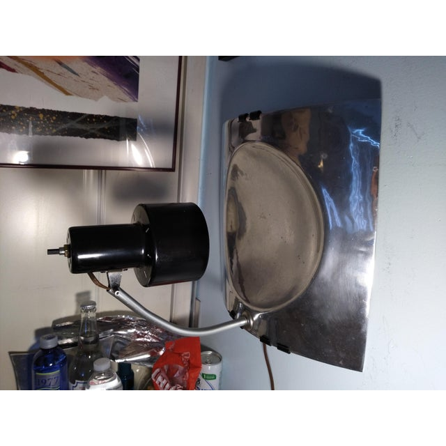 This is a reflector wall sconces or ceiling mount it can also rest on a table.