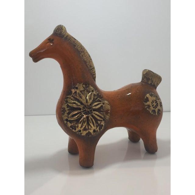 Beautiful Bittosi mid-century horse. Gold and orange ceramic sculpture .