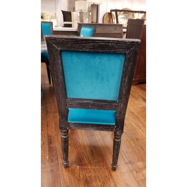The texture of this black cerused oak, square back frame dining chair, upholstered in turquoise velvet is so bold!