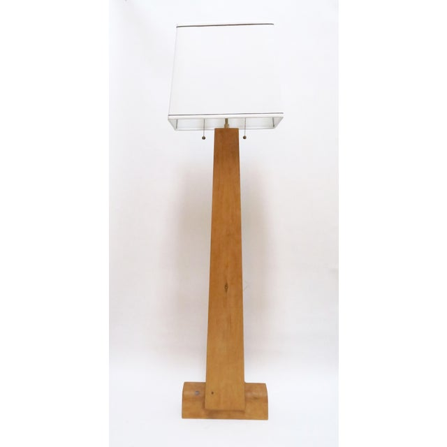 Notch floor lamp in solid pine that has been wax sealed. Linen shade with black trim. 2 bulbs with brass pull cords.