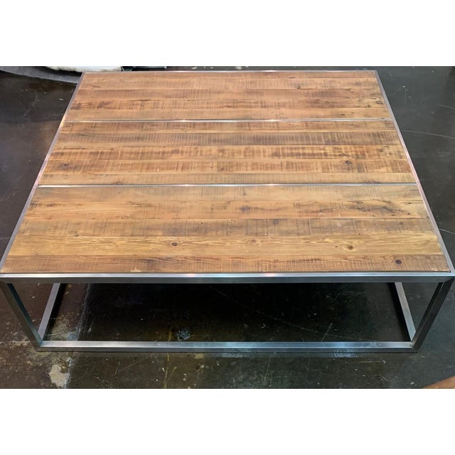 Distressed wood planks and chrome frame coffee table. Extra large in size, perfect for larger living/family rooms. Easily...