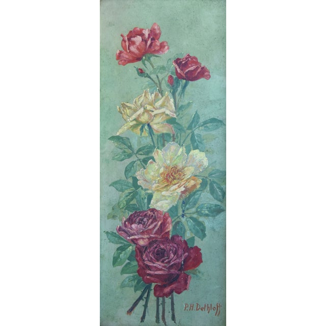 """Antique oil painting on artist canvas panel of red and yellow roses. Signed """"P.H. Delhloff"""" bottom right. Displayed in a..."""