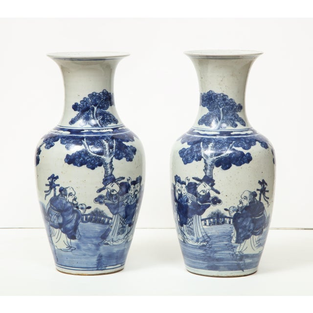 A pair of lovely Chinese export porcelain vases with a bottle neck. This pair have a timeless quality about them. They are...