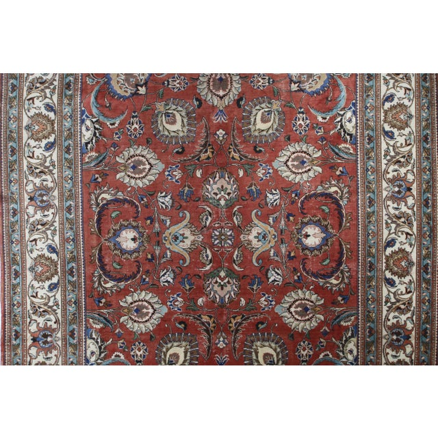 Distressed Vintage Persian Tabriz Rug with Traditional style. This hand-knotted wool vintage Persian Tabriz rug features...