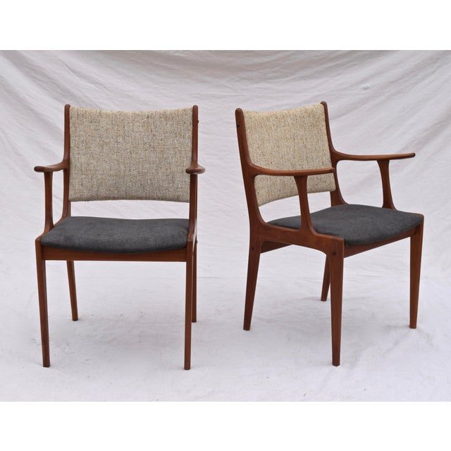 A set of six teakwood dining armchairs in the sculptural organic form typical of Johannes Andersen designs; manufactured...
