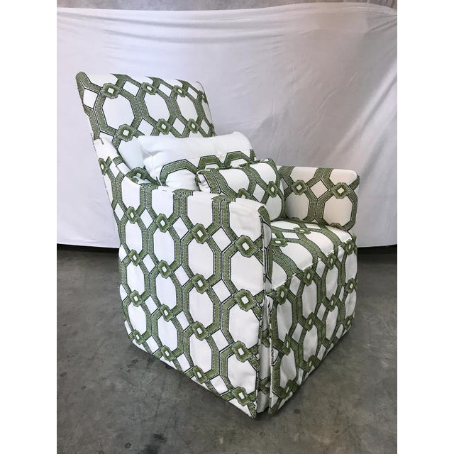 The Blakley Swivel Chair is a first quality market sample that features a Green and White Fabric with a Blend Down Pillow.