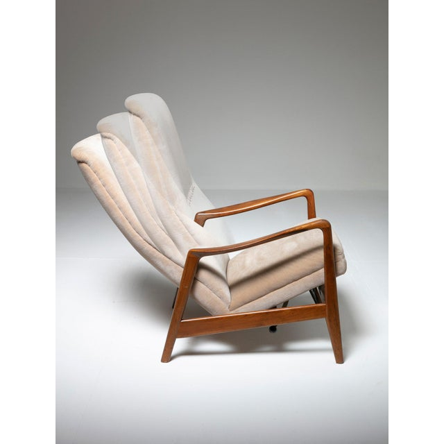 Reclining chair model 829 by Arnestad Bruk for Cassina. Walnut frame, original fabric and mechanical system allowing 8...
