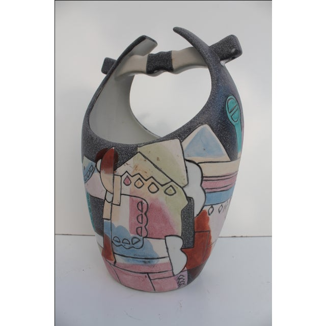 Vintage decorative vase featuring a Mid-Century Modern-style, hand-done cubist painting. Signed bottom by Kiln Art....