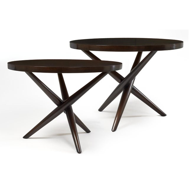 A pair of lamp tables with round tops supported by a criss-cross tripod base. Model no. 1641. By T.H. Robsjohn-Gibbings...