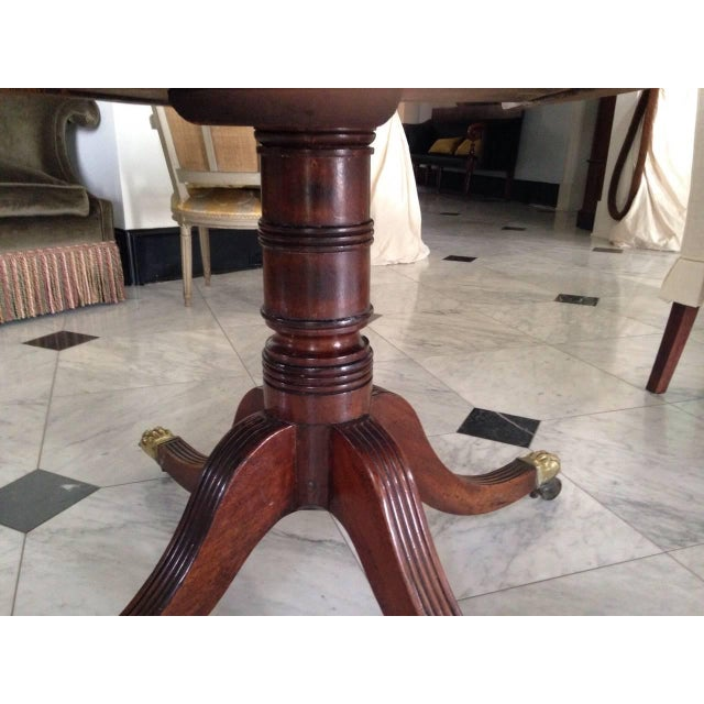 Georgian English Georgian Tilt-Top Mahogany Supper Table with Brass Lion's Paw Feet For Sale - Image 3 of 5
