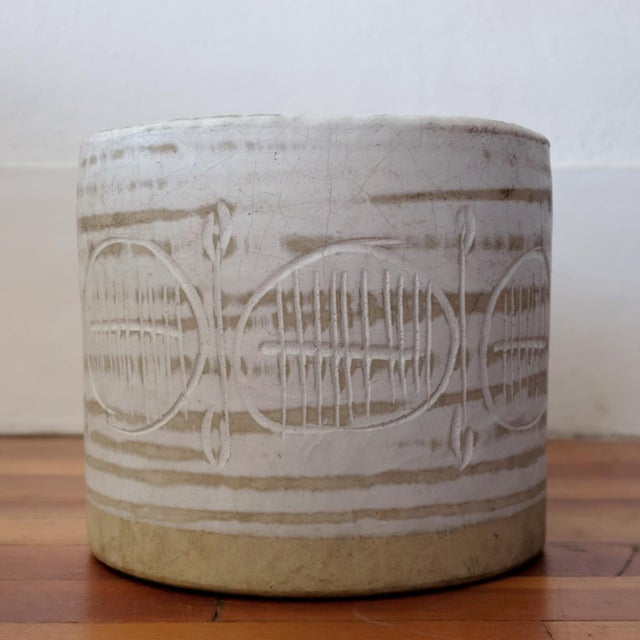 Ceramic planter by Jane and Gordon Martz for their company, Marshall Studios. Natural tan clay, brushed white glaze and an...