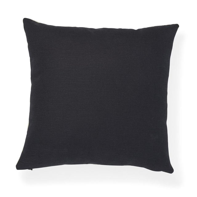 "The face of this 16"" x 16"" pillow features Mottley Grid in Wren paired with Langham in Onyx on the back. A small-scale..."