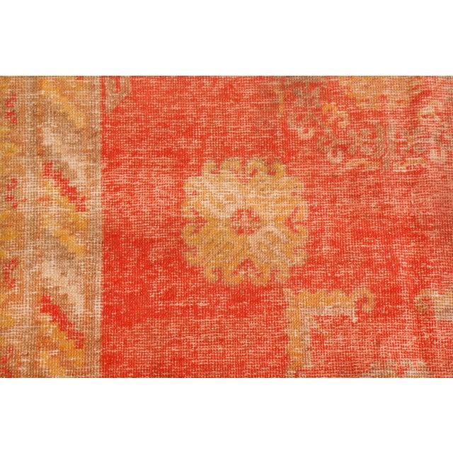 Originating from East Turkestan between 1920-1940, this semi-antique transitional Khotan rug from Rug & Kilim is entering...