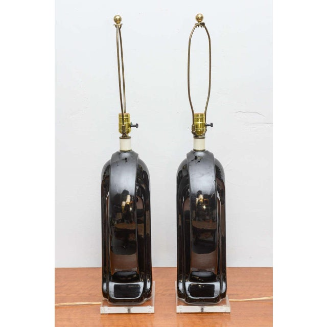 Stunning pair of black ceramic with Lucite base lamps, USA, 1950s.