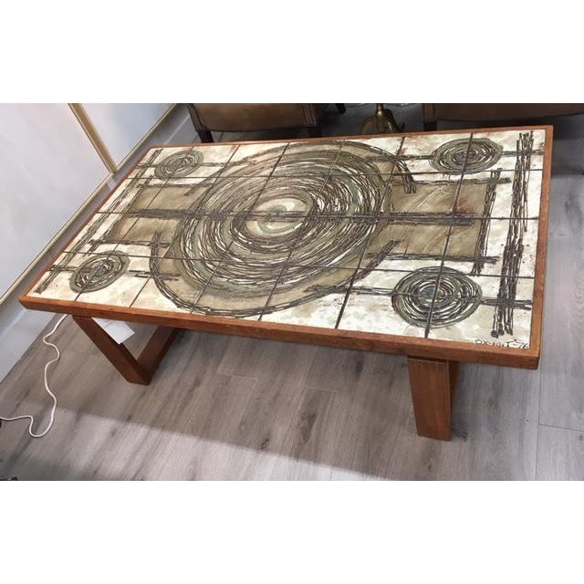 Unusual and hand crafted; signed 1976; vintage tile top with teak base
