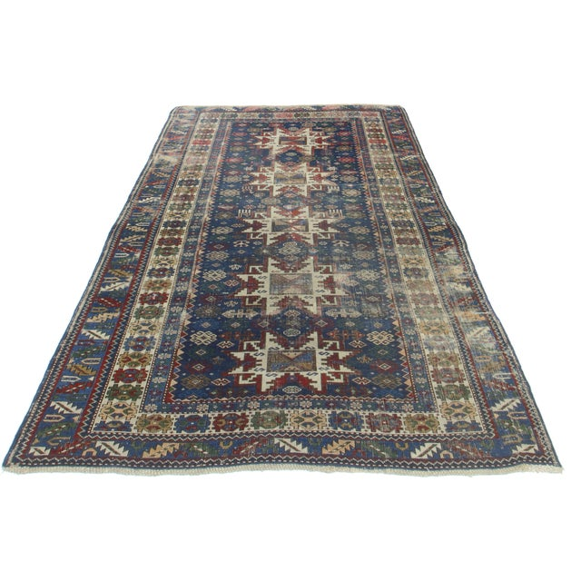 Here is a lovely Russian rug with a geometric design. Made of hand-knotted wool.