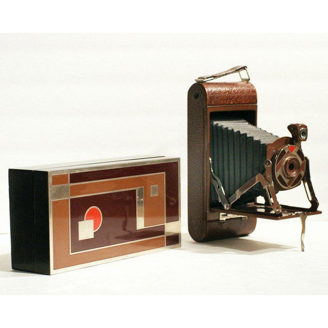 Walter Dorwin Teague (1883-1960) designed this Art Deco camera and box in 1930 for the Eastman-Kodak Company in Rochester,...