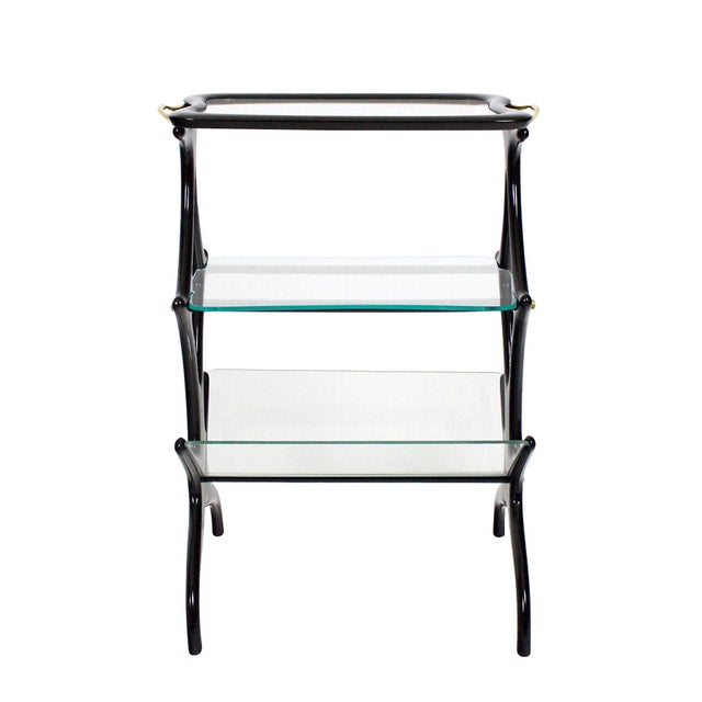 Sidetable with magazine rack, stained beech, french polish, glasses, polished brass handles and hardware. Design: Cesare...