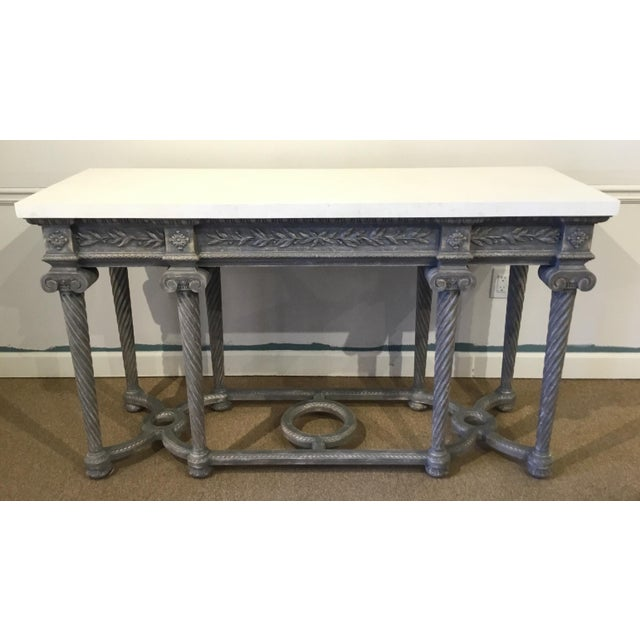 Elegant transitional Henredon white marble French style console table, gray wood carved base and a white marble top,...