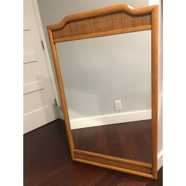 Charming and refined. A reminder of a faraway land of exotic beaches. Large 1960s midcentury mirror that will brighten and...