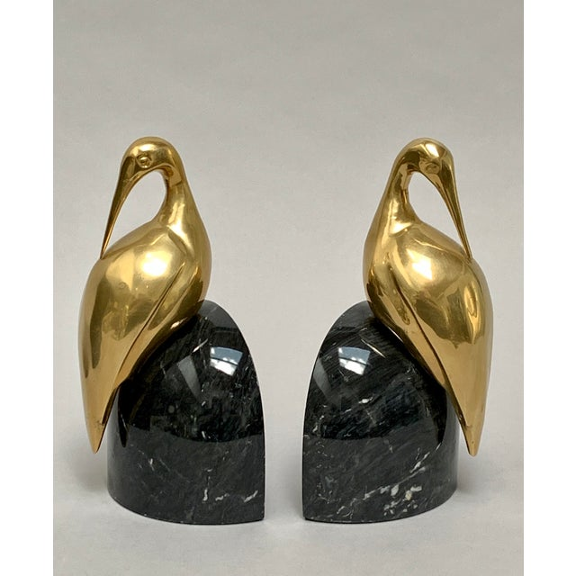 Art Deco brass and marble egret bookends – a Pair An elegant pair of brass wading birds (which appear to be egrets, cranes...