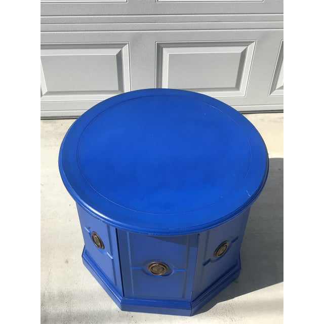 Beautiful vintage cobalt blue side cabinet. One of the panels opens up to offer loads of hidden storage while the large...