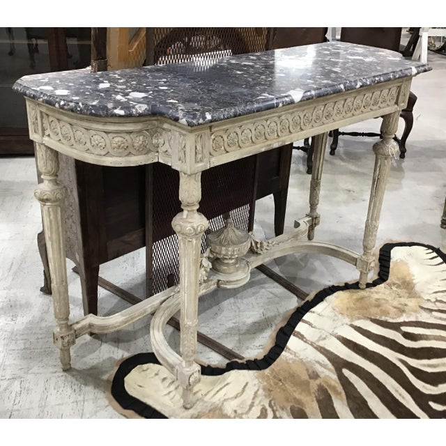 19th Century carved Louis XVI style console table. Antique European pine, with beautiful distressed patina. You can see...